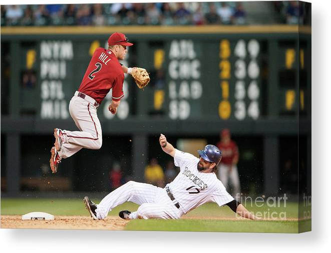 Double Play Canvas Print featuring the photograph Todd Helton and Aaron Hill by Dustin Bradford