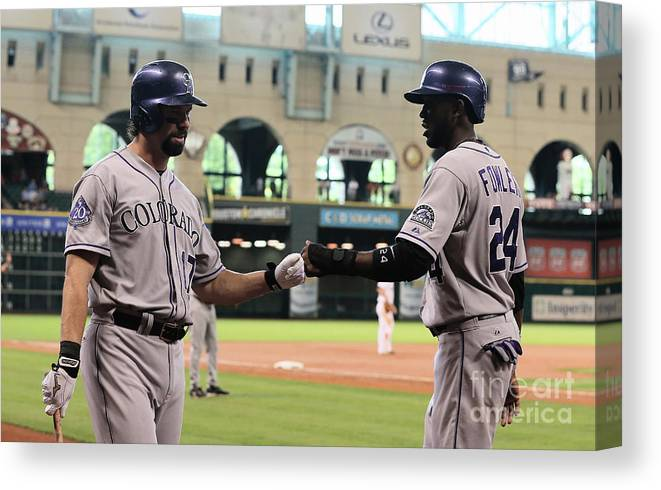 American League Baseball Canvas Print featuring the photograph Todd Helton and Dexter Fowler by Scott Halleran