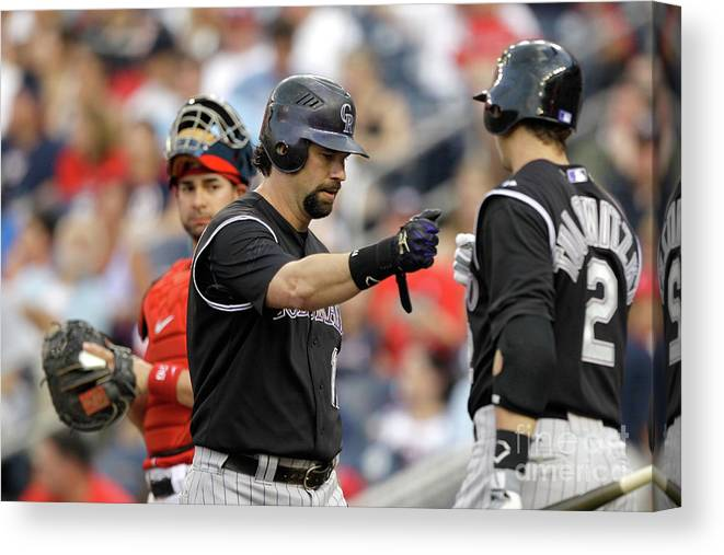 People Canvas Print featuring the photograph Todd Helton and Troy Tulowitzki by Rob Carr