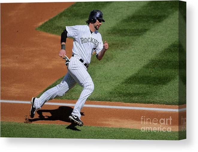 Scoring Canvas Print featuring the photograph Todd Helton, Manny Parra, and Garrett Atkins by Doug Pensinger