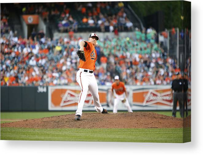 Ninth Inning Canvas Print featuring the photograph Toronto Blue Jays v Baltimore Orioles by Jonathan Ernst