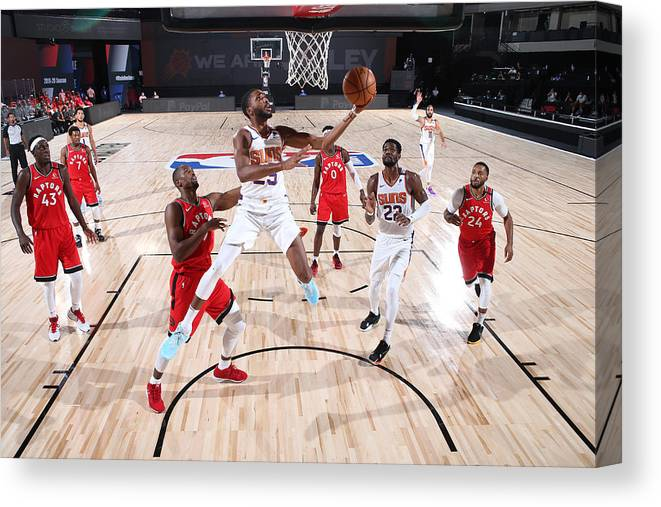 Nba Pro Basketball Canvas Print featuring the photograph Toronto Raptors v Phoenix Suns by David Sherman