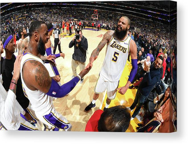 Nba Pro Basketball Canvas Print featuring the photograph Tyson Chandler and Lebron James by Andrew D. Bernstein