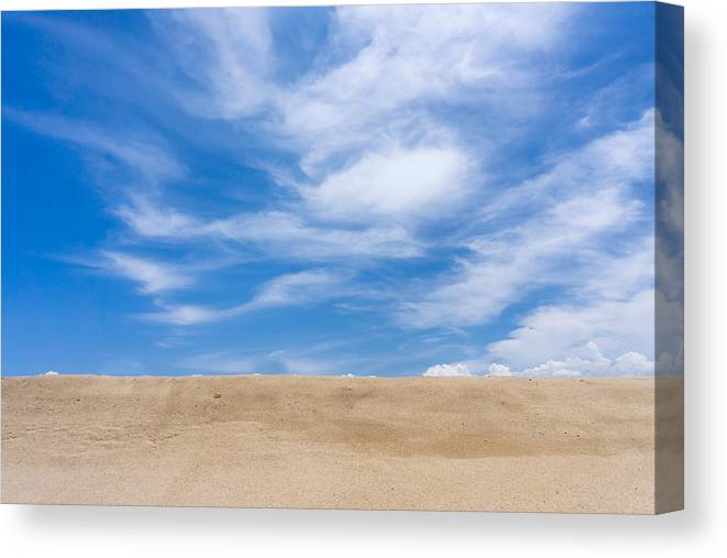 Tranquility Canvas Print featuring the photograph View Of Sand Against Blue Sky And Clouds by Jesse Coleman / Eyeem