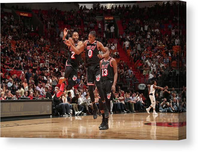 Nba Pro Basketball Canvas Print featuring the photograph Wayne Ellington and Josh Richardson by Issac Baldizon