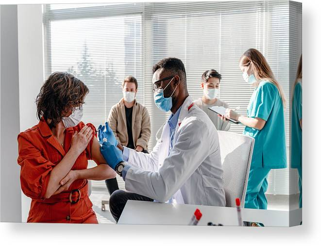 Young Men Canvas Print featuring the photograph Women With Face Mask Getting Vaccinated, Coronavirus, Covid-19 And Vaccination Concept by Phynart Studio