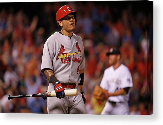 St. Louis Cardinals Canvas Print featuring the photograph Yadier Molina and Scott Oberg by Doug Pensinger