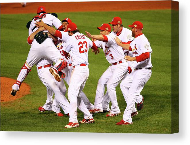 St. Louis Cardinals Canvas Print featuring the photograph Yadier Molina, Gerald Laird, and David Freese by Dilip Vishwanat