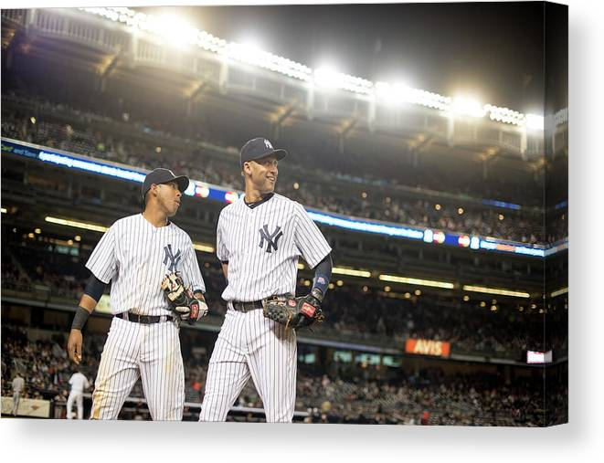 American League Baseball Canvas Print featuring the photograph Yangervis Solarte and Derek Jeter by Rob Tringali