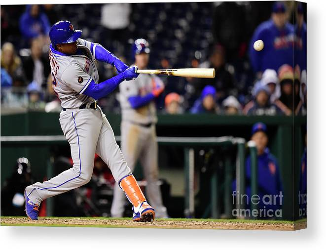 Yoenis Cespedes Canvas Print featuring the photograph Yoenis Cespedes and Juan Lagares by Patrick Mcdermott