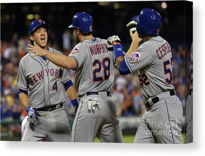 Yoenis Cespedes Canvas Print featuring the photograph Yoenis Cespedes, Daniel Murphy, and Wilmer Flores by Drew Hallowell