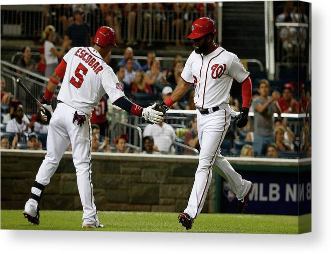People Canvas Print featuring the photograph Yunel Escobar and Denard Span by Rob Carr