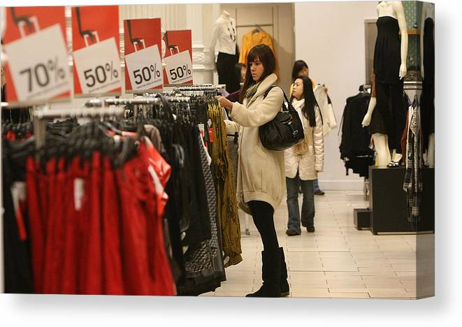 Retail Canvas Print featuring the photograph Shoppers Take Advantage Of Post Christmas Bargains by Mario Tama