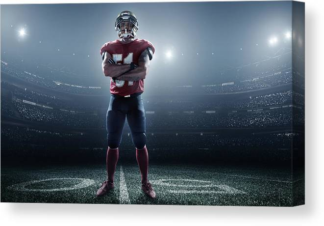 Soccer Uniform Canvas Print featuring the photograph American Football In Action by Dmytro Aksonov