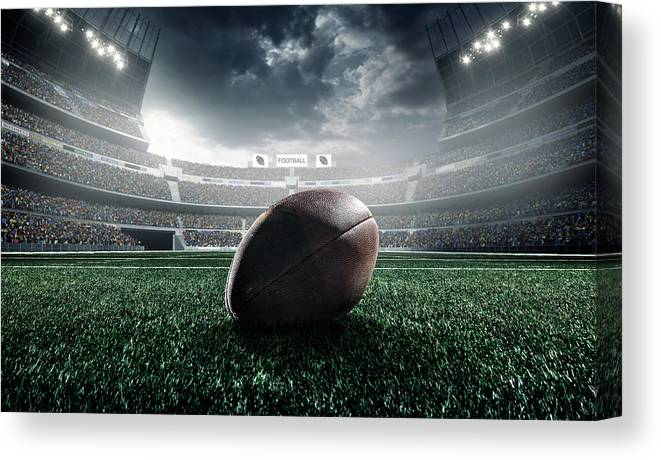 Event Canvas Print featuring the photograph American Football Ball by Dmytro Aksonov