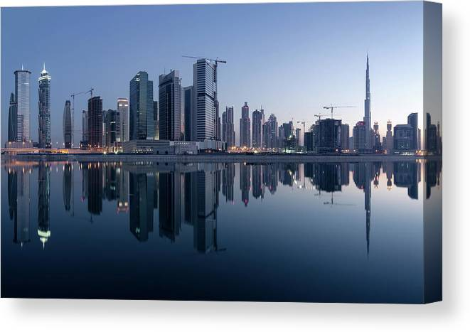 Tranquility Canvas Print featuring the photograph Dubai Business Bay Skyline With by Spreephoto.de