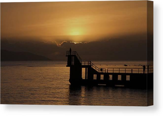 #galwaybay #galway #theprom #blackrock #salthill #ireland #travel #sunset #wildatlanticway #seascape #tourism #failteireland #sea #aranislands #silhouette #sun #irish #galwaygirl #tourism #landmark #divingboard #sundown Canvas Print featuring the photograph Sunset on Galway Bay by Rachel Dubber