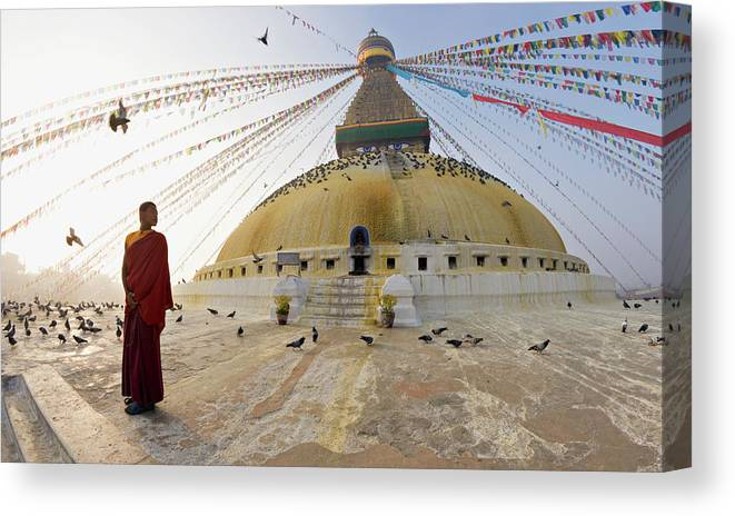 Young Buddhist Monk Turns To Look At The Dome Of Boudha (bodhnath) (boudhanath) Tibetan Stupa In Kathmandu Canvas Print featuring the photograph 755-3 by Robert Harding Picture Library