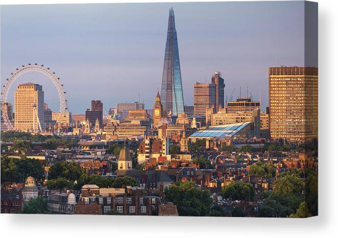 Tranquility Canvas Print featuring the photograph City Skyline In Late Evening Sunlight by Simon Butterworth