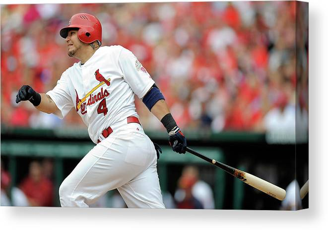 Following Canvas Print featuring the photograph Yadier Molina by Jeff Curry