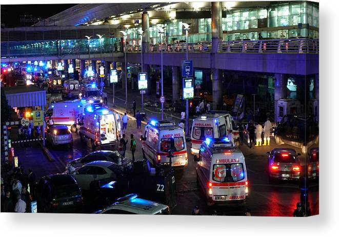 Ambulance Canvas Print featuring the photograph At Least 10 Killed In Suicide Bomb Attack On Ataturk International Airport In Istanbul by Getty Images