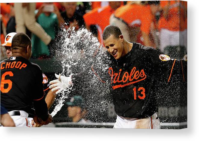 People Canvas Print featuring the photograph Manny Machado and Jonathan Schoop by Rob Carr