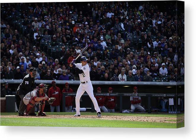 Baseball Catcher Canvas Print featuring the photograph Troy Tulowitzki and Miguel Montero by Doug Pensinger