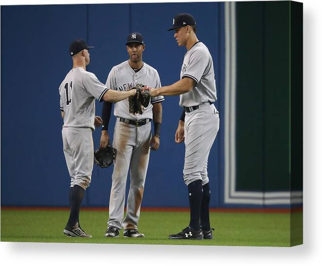 People Canvas Print featuring the photograph New York Yankees v Toronto Blue Jays by Tom Szczerbowski