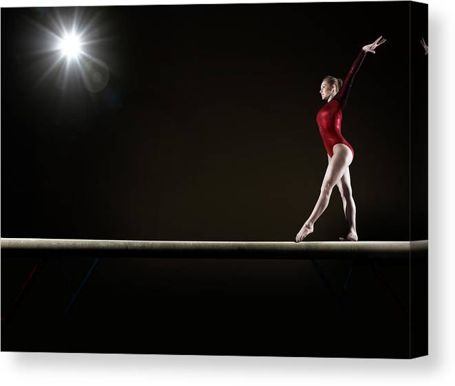 Human Arm Canvas Print featuring the photograph Female Gymnast Balancing On Beam by Mike Harrington