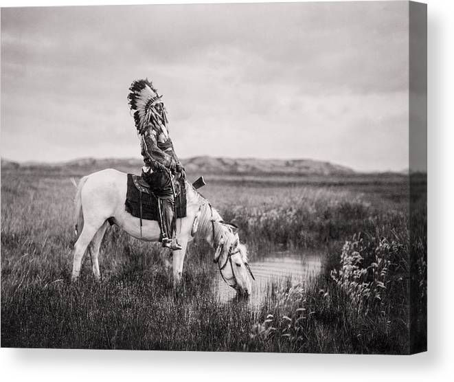 1905 Canvas Print featuring the photograph Oglala Indian Man circa 1905 by Aged Pixel