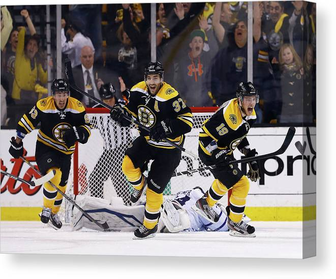 Following Canvas Print featuring the photograph Toronto Maple Leafs V Boston Bruins - by Jared Wickerham