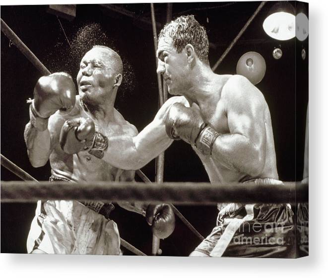 People Canvas Print featuring the photograph Rocky Marciano Defeats Jersey Joe by Bettmann