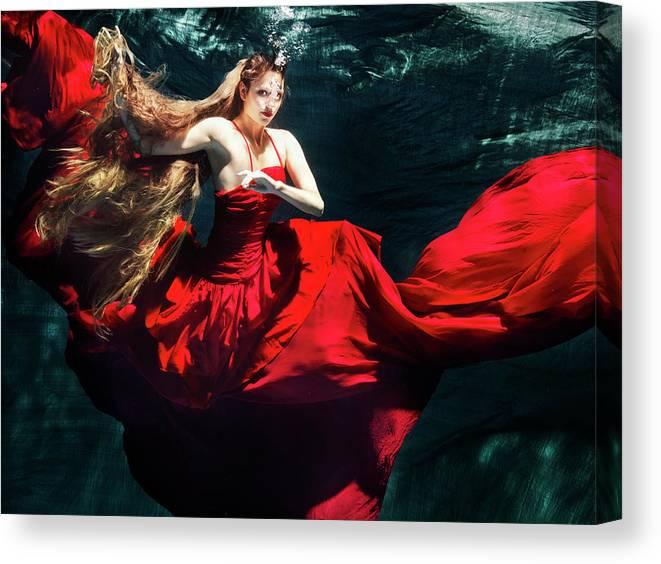Ballet Dancer Canvas Print featuring the photograph Female Dancer Performing Under Water by Henrik Sorensen
