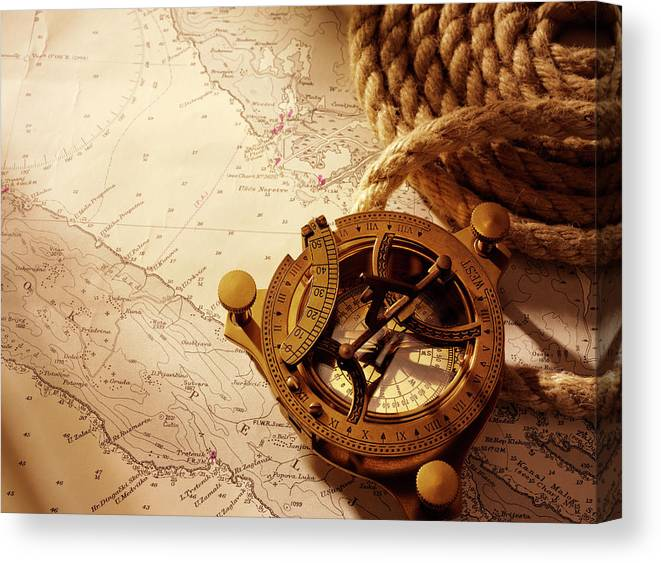 Rope Canvas Print featuring the photograph Coiled Rope And Nautical Chart With A by Wragg