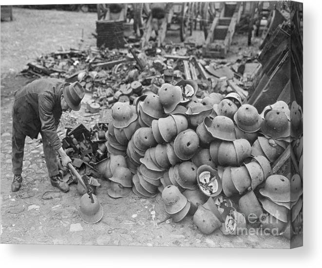Versailles Canvas Print featuring the photograph German Helmets Stacked For Elimination by Bettmann