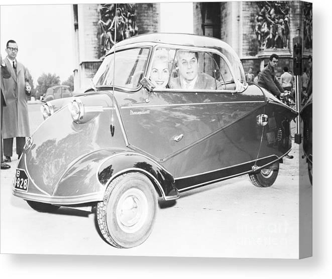 People Canvas Print featuring the photograph Janet Leigh And Tony Curtis In Minicar by Bettmann