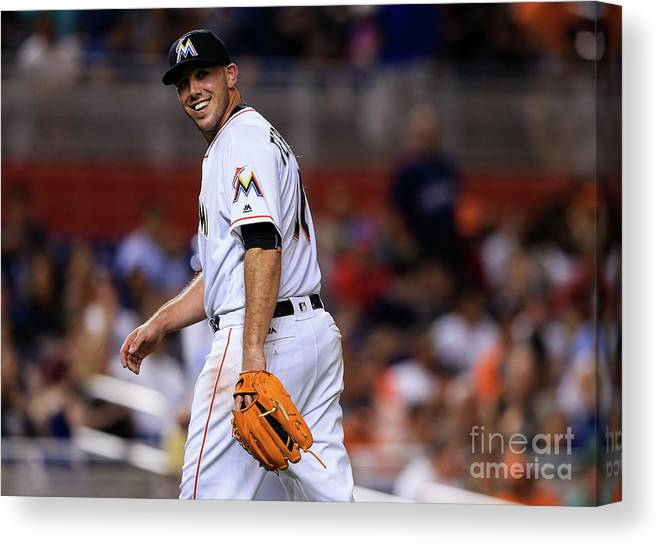 Looking Over Shoulder Canvas Print featuring the photograph Kansas City Royals V Miami Marlins by Rob Foldy
