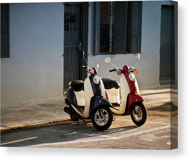 In A Row Canvas Print featuring the photograph Motorbikes Parked On The Road by Pgiam