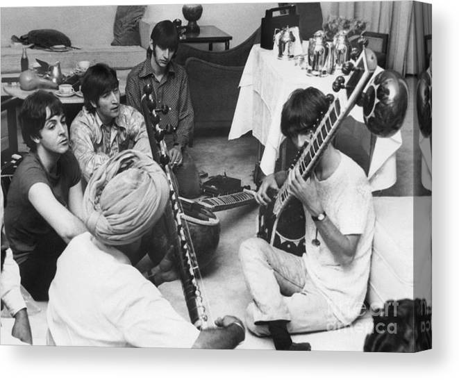 Education Canvas Print featuring the photograph Musician George Harrison Receiving by Bettmann