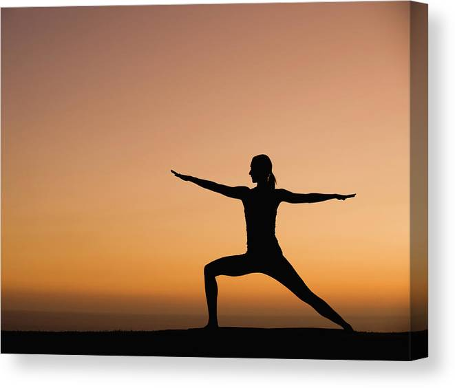 Tranquility Canvas Print featuring the photograph Silhouette Of Woman Doing Yoga by Erik Isakson
