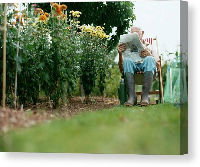 Grass Canvas Print featuring the photograph Unrecognisable Man Sits Reading A by Iain Crockart