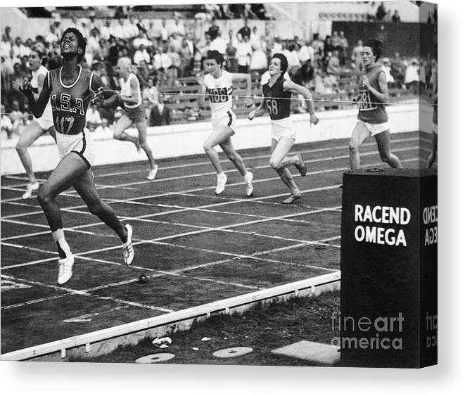 Event Canvas Print featuring the photograph Wilma Rudolph Sprinting Across Finish by Bettmann