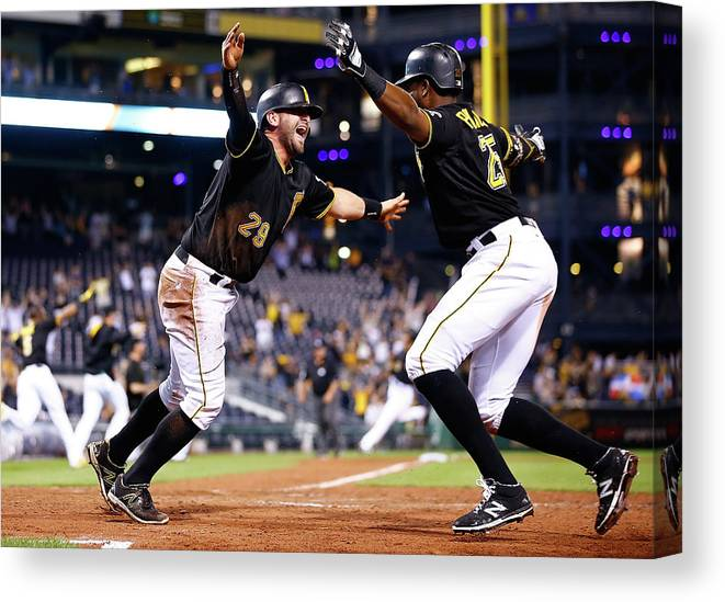 People Canvas Print featuring the photograph Francisco Cervelli and Gregory Polanco by Jared Wickerham