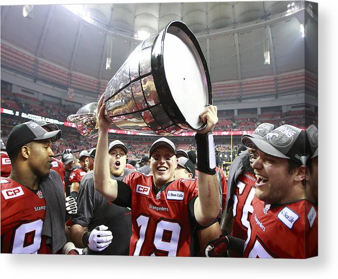 Hoisting Canvas Print featuring the photograph 102nd Grey Cup Championship Game by Jeff Vinnick