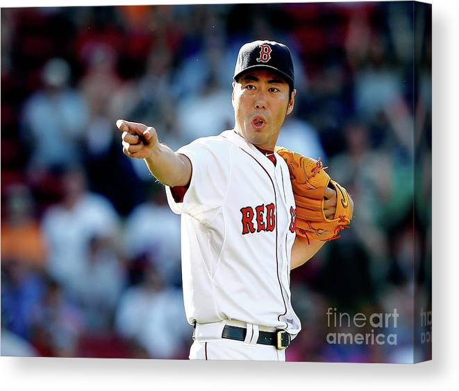 American League Baseball Canvas Print featuring the photograph Koji Uehara by Jim Rogash