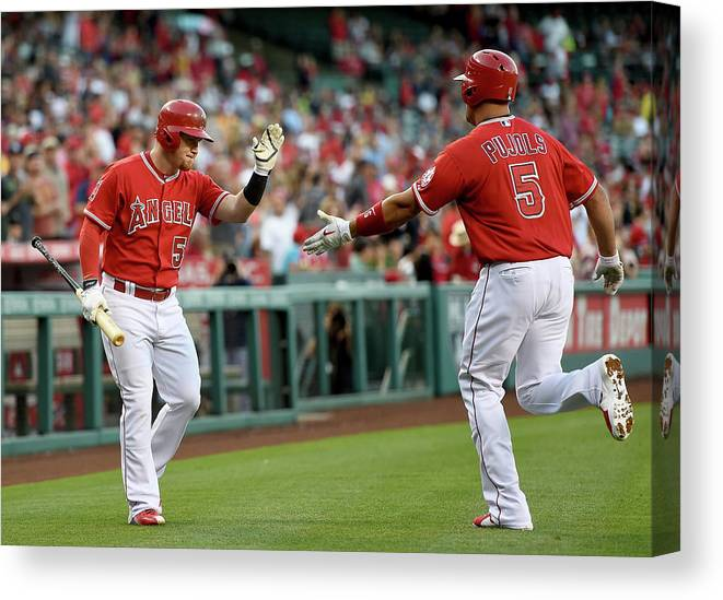 People Canvas Print featuring the photograph Albert Pujols and Kole Calhoun by Harry How