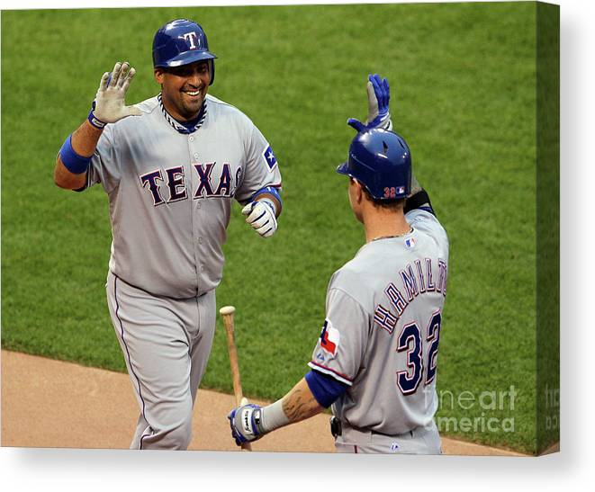 American League Baseball Canvas Print featuring the photograph Bengie Molina and Josh Hamilton by Justin Sullivan