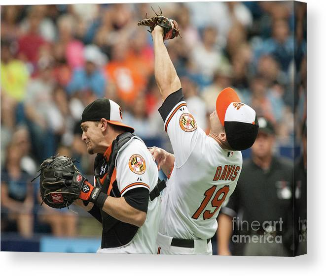 American League Baseball Canvas Print featuring the photograph Chris Davis and Caleb Joseph by Cliff Mcbride
