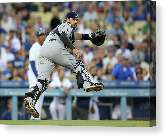 Baseball Catcher Canvas Print featuring the photograph Dee Gordon and Rene Rivera by Stephen Dunn