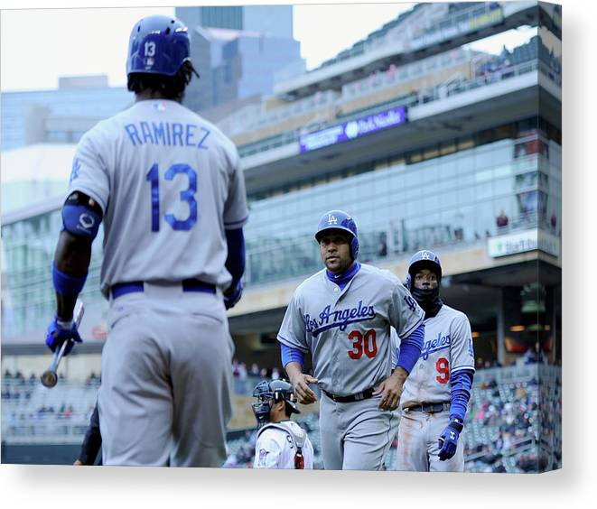 Second Inning Canvas Print featuring the photograph Dee Gordon, Hanley Ramirez, and Miguel Olivo by Hannah Foslien